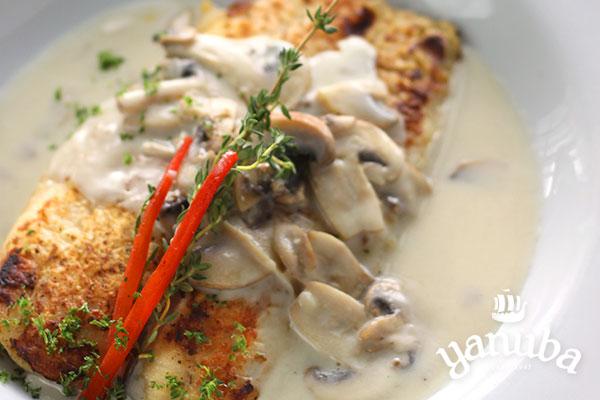 Pescado blanco en salsa de champiñones